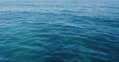 Flying Over Deep Blue Ocean. 4K Aerial View. Stock Footage