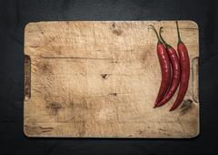 Red chilies on a rustic chopping board background Stock Photos