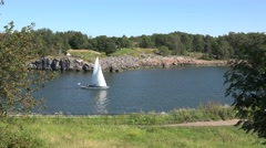 A sailng boat passing through two pieces of land,  Suomenlinna, Finland. Stock Footage