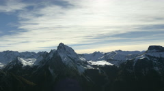 Mountain range landscape with snow capped peaks Stock Footage