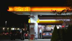 4K, Shell gas station customers pump fuel Stock Footage