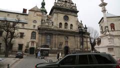 People near the Bernardine church and monastery in Lviv, Western Ukraine Stock Footage