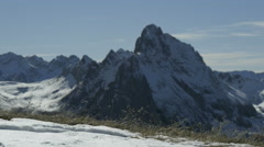 High mountains thaw with snow capped peak in the background Stock Footage