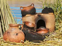 Traditional mad pans, Uros, Peru, Bolivia. Stock Photos