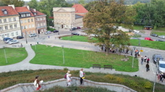 Tourist group on excursion, people sightseeing in historic part of European city Stock Footage