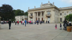 Large crowd of tourists walking in front of Lazienki Palace in Warsaw, Poland Stock Footage