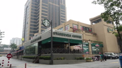 A view of Starbucks Coffee and its outdoor cafe at Plaza Massalam Stock Footage