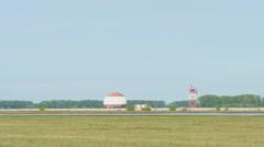 Airplane landing on runway Stock Footage