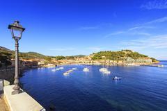 Elba island, Porto Azzurro village bay. Marina and street lamp. Tuscany, Ital Stock Photos