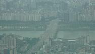 Stock Video Footage of Traffic On Bridge Crossing River Aerial View