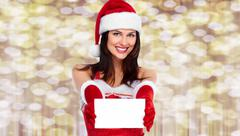 Happy Christmas girl with greeting card. Stock Photos