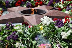 The laid flowers to an eternal flame in honor of a Victory Day on May 9 Stock Photos