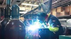 welder welding exhaust duct fabricated on industrial machine 2 - stock footage
