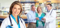 Elderly pharmacist doctor woman. Stock Photos