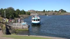 A JT -Line waterbus (in 4k) pulling in to Suomenlinna, Helsinki, Finland. Stock Footage