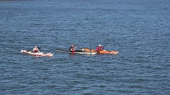 Three men kayaking (in 4k) near the fortress of Suomenlinna, Helsinki, Finland. Stock Footage