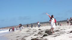 People excited and jumping around on a beach. Pebble Beach, California. Stock Footage