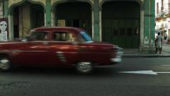 Cherry colored classical american car on the street of old Havana Stock Footage
