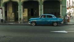 Street side view of classic american cars and buildings in Havana Stock Footage