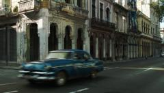 Rustic Havana architecture and classic american car driving Stock Footage