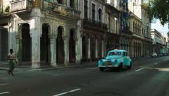 Everyday moment on a rustic old Havana street Stock Footage