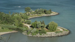 Aeriel view of man made lakeshore path Stock Footage