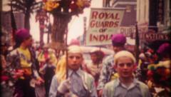 2650 - Mardi Gras street scene, crowds, costumes,tourist-vintage film home movie Stock Footage