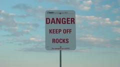 Danger keep off rocks Stock Footage