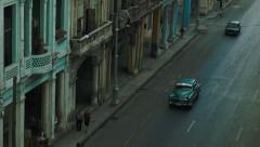 Classic cars on the street in Havana seen from above Stock Footage