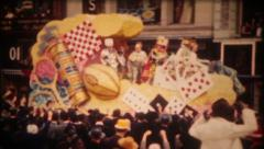 2654 - Mardi Gras parade, floats, crowds, costumes - vintage film home movie Stock Footage
