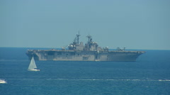 US Carrier Anchored off Shore Stock Footage