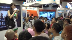 4K asian crowd people get a gift from a sexy woman in Expo Computer Taipei-Dan Stock Footage