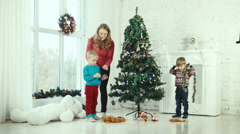 Mother and children decorate the Christmas tree Stock Footage