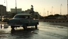 Turning classic cars on main street in Havana Stock Footage