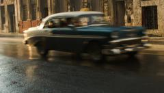 Sunset golden hour light on Havana street with classic cars Stock Footage