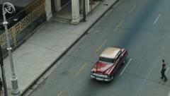 Man crossing a busy with cars street in Havana Stock Footage