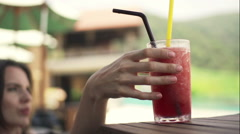 Young woman drinking cocktail on sunbed, slow motion 120fps Stock Footage