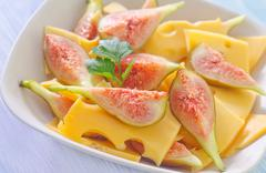 Cheese and figs Stock Photos