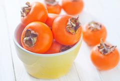 juicy persimmon - stock photo