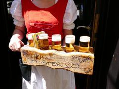 Europe Germany Cologne Köln Koln Koeln waitress holding beer tray - stock photo