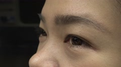 Closeup Shot Of Asian Girl Eye travel in the metro 4K-Dan Stock Footage