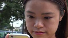4K Asian Woman Using Smart Phone in the street do some quick text messaging-Dan Stock Footage
