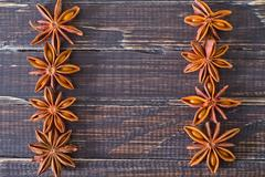 Stock Photo of anise on wooden board