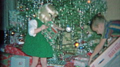 1963: Kid unwrapping road rage electric slot car racer toy for Christmas gift. Stock Footage