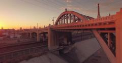 People gather on historic 6th Street Bridge in Los Angeles sunset Aerial view 4K - stock footage