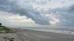 People Walking on Beach with a Storm Coming on Sanibel Island Stock Footage