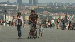 Parents with little boy walking in Hradcany Square, Prague Stock Footage