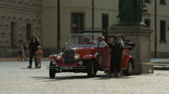 Vintage car in Hradcany Square, Prague Stock Footage