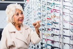 Retiree looking for new eyeglasses - stock photo