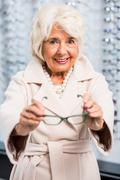 Stock Photo of Happy client with new eyeglasses